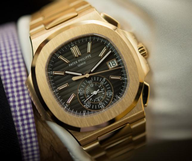 ae741623904 Patek Philippe Nautilus collection has a classic model which is all made of  rose gold. The Nautilus watches have unique cases who shape is integrated  with ...