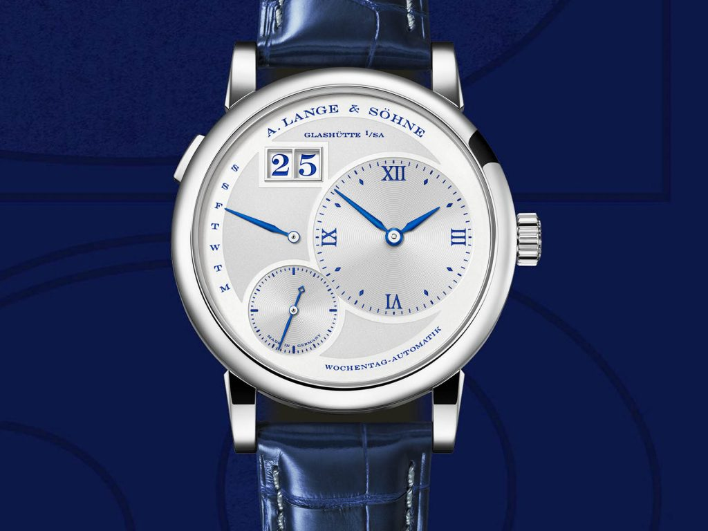 The 18k white gold fake watch has blue strap.