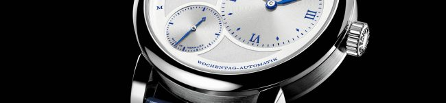 The silvery dial fake watch is designed for men.